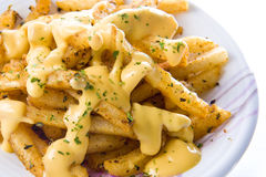 Cheese Fries. A plate of hot, sizzling pepper fries topped with delicious melted cheese stock photo