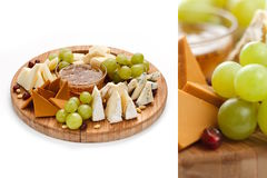 Cheese and fruit. Platter isolated on white Stock Photography