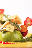 Cheese and fruit appetizer Stock Image