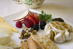 Cheese and Fruit Appetizer Plate Stock Image