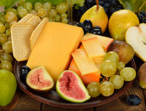 Cheese and fruit Stock Images