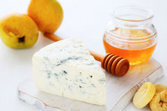 Cheese with fruit and maple syrup Stock Photography