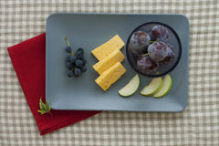 Cheese and fruit plate. With red napkin Royalty Free Stock Photography