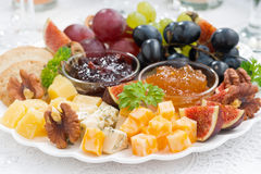 Cheese and fruit plate to the holiday, closeup Royalty Free Stock Photo