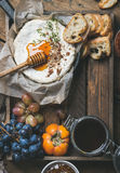 Cheese, fruit and wine set over wooden background, copy space Royalty Free Stock Images