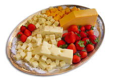 Cheese and fruits. A big plate full of different kinds of cheese with strawberries isolated on white studio background Stock Photo