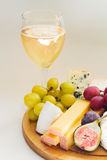 Cheese and fruits Stock Image