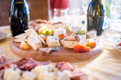Cheese and fruits as appetizer at reception party Royalty Free Stock Photos