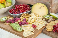 Cheese and fruits on a beautifully vintage decorated table Royalty Free Stock Photos
