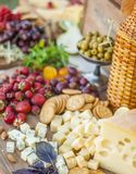 Cheese and fruits on a beautifully vintage decorated table Stock Image