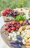 Cheese and fruits on a beautifully vintage decorated table Stock Photo