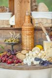 Cheese and fruits on a beautifully vintage decorated table Stock Images