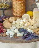 Cheese and fruits on a beautifully vintage decorated table Stock Photos