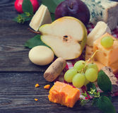 Cheese and fruits Royalty Free Stock Photos