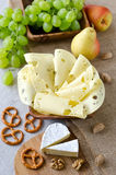 Cheese with fruits and nuts Stock Photos