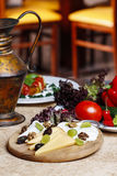 Cheese and fruits wooden platter with vegetables Stock Photo