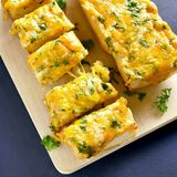 Cheese and garlic bread with greens royalty free stock photography