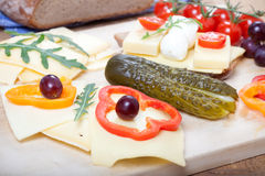 Cheese on german bread with sweet pepper, grapes, cucumber, tomatoes Royalty Free Stock Photos