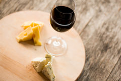 Cheese and glass of  red wine on salver Stock Image