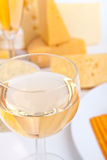 Cheese and glass of wine Royalty Free Stock Images