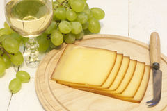 Cheese and glass of wine closeup Stock Photo
