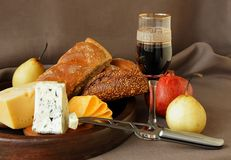 Cheese, a glass of wine, fruit and bread. Royalty Free Stock Photos
