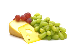 Cheese and grape Stock Photos