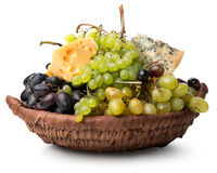 Cheese and grape in basket Royalty Free Stock Image