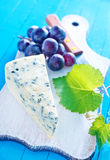 Cheese. With grape on board Stock Photography