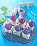 Cheese. With grape on board Stock Photos