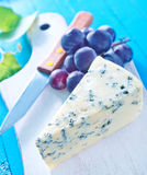 Cheese. With grape on board Royalty Free Stock Images
