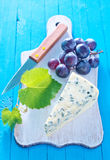 Cheese. With grape on board Stock Photo