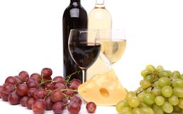 Cheese, grape, bottles and glasses of wine Stock Images