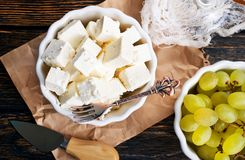 Cheese and grape. Cheese and white grape on a table Royalty Free Stock Photography