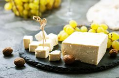 Cheese and grape. Cheese and white grape on a table Royalty Free Stock Photos
