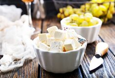 Cheese and grape. Cheese and white grape on a table Stock Photos