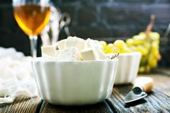 Cheese and grape. Cheese and white grape on a table Stock Images