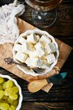 Cheese and grape. Cheese and white grape on a table Royalty Free Stock Images