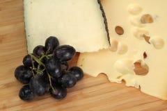 Cheese and grape macro shot Stock Images