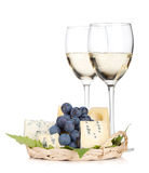 Cheese, grape and two white wine glasses. On white background Royalty Free Stock Photo