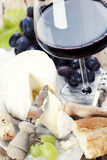 Cheese, grape and wine. On wooden table Stock Image