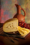 Cheese, grape and wine. Still-life with grape, cheese and wine Stock Photos