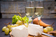 Cheese with grape and wine. White cheese, grape and lettuce with white wine Royalty Free Stock Photography