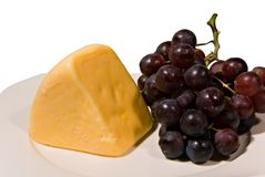 Cheese and Grapes. A plate of cheese and purple grapes Stock Photo