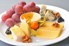 Cheese and grapes Stock Photo
