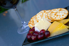 Cheese and grapes stock photography