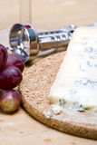 Cheese and grapes. A delicious platter of blue cheese and fresh grapes royalty free stock image
