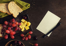 Cheese, grapes, cherry, bread dark rustic mock up Royalty Free Stock Image