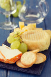 Cheese with grapes and cookies and glass Stock Photo