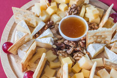 Cheese with grapes, crackers, nuts Stock Photography
